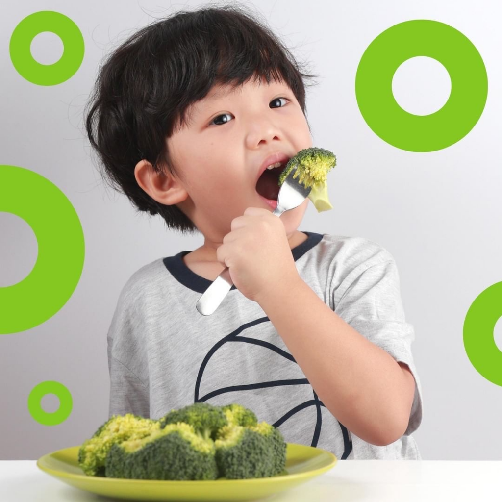 """A kid is eating broccoli. The image will link you to the blog post """"what is autonomy?"""""""